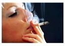 Sigaramın dumanına sarsam saklasam seni