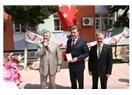 Mersin'in Toroslar İlçe Belediye Başkanı Tuna'ya Eğitim plaketi...