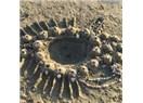 Kumda oynarken