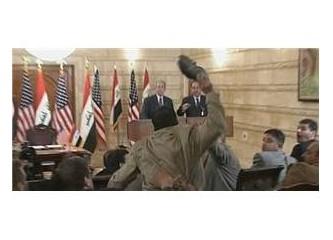 George W. Bush'a ayakkabılı veda öpücüğü