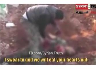 Suriye muhalif askeri Esad'ın askerinin kalbini kesip yiyor. Vahşetin nedenleri